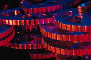 image of interlocking and stacked, copper-colored gears, nicely lit and aesthetically presented
